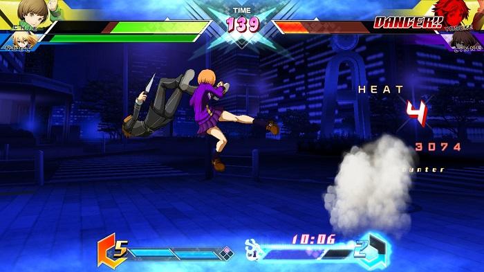 Chie Satonaka kicks Yosuke Hanamura in BBTAG.