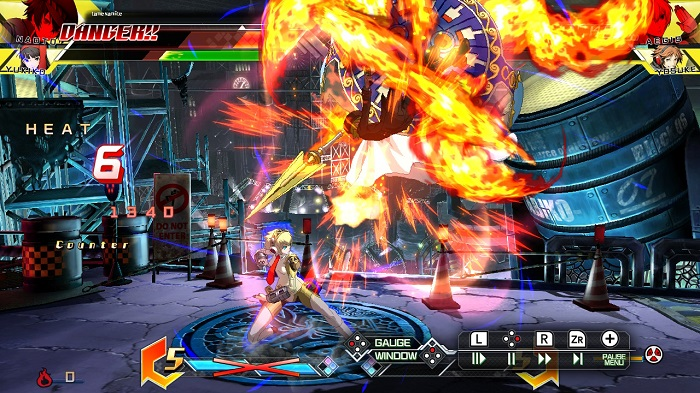 Aegis lading her Megido Fire in BBTAG's Replay Theater.