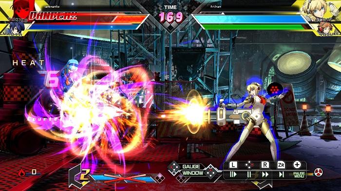 Aegis guns down Yosuke in BBTAG.